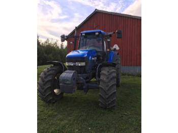 New Holland TM115  - колёсный трактор
